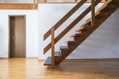 Stairs to attic. Modern wooden staircase leading up to attic Stock Photos