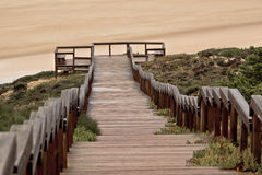 Stairs to beach. Stairs going to the beach in Monte Clerigo Aljezur in Portugal Royalty Free Stock Photo