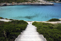Stairs to the beach. Stairs descending to a clear water lagoon Stock Photos