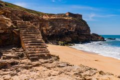 Stairs to the beach of the Atlantic Ocean in the Nazare in Portugal. Stairs to the beach of the Atlantic Ocean at the lighthouse in the town of Nazare in stock images