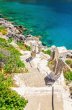 Stairs to the beach with green bushes, Greece Stock Images