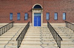 Stairs to blue doors royalty free stock images