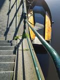 Stairs to boat on waterfront Royalty Free Stock Photo