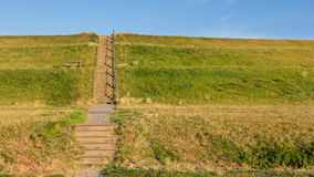 Stairs to cross a Dutch dyke Royalty Free Stock Photos