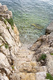 Stairs to the crystal clear sea Stock Photo