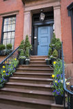 Stairs to a doorway of an old apartment, New York City Stock Photo