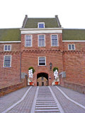 Stairs to entrance balloon decoration. Symmetrical perspective view at the arch shaped entrance with stairs of Castle Woerden, the Netherlands, decorated with Royalty Free Stock Photo