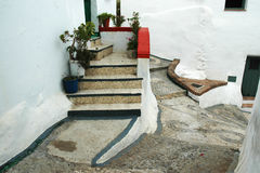 Stairs to entry door in a narrow alley Stock Images