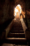 Stairs to the exit of the cave Royalty Free Stock Photos