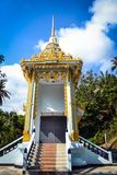 Stairs to the golden entrance of the Buddhist temple at a small Thai village. In Asia Royalty Free Stock Photography