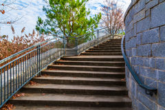 Stairs to Grand Arbor in Piedmont Park, Atlanta, USA. Curved staircase to Grand Arbor in the Piedmont Park in sunny autumn day, Atlanta, USA royalty free stock photos