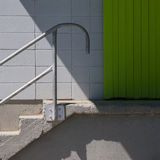 Stairs to Green Door of Loading Dock Royalty Free Stock Image