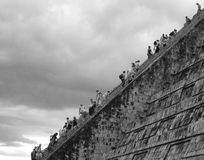 Stairs to Heaven. Tourists from all over the World are climbing to the top of El Castillo, the pyramid in Chichen Itza, Mexico royalty free stock photos