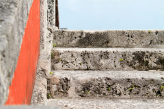Stairs to heaven. Coral rock stairs leading to light blue sky Royalty Free Stock Photo