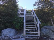 Stairs to heaven. Stairs down to beach which had old ship Royalty Free Stock Photography