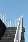 Stairs to heaven. Exterior staircase leading up to roof of structure with view towards clear blue summer skies at Fort Taylor in Key West, south Florida Royalty Free Stock Images