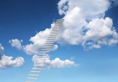 Stairs to heaven leaning to white clouds royalty free stock photos