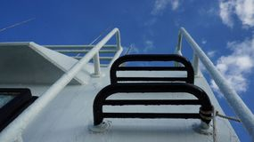 Stairs to heaven. Stairway on ship leading upright direction heaven. conceptual photography of steps on a white boat for the peaceful life or the success in life Stock Photography