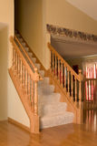 Stairs to level one. Stairs with side rails to level of the house Stock Photos
