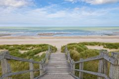 Stairs to the North Sea beach at Blankenberge, Belgium. Wooden stairs through the dunes down to the North Sea beach at Blankenberge, Belgium stock photos