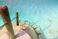 Stairs to the ocean. A short flight of stairs into the ocean at Rihiveli island, Maldives Royalty Free Stock Image