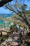 Stairs to the ocean in North Stratbroke Island stock photos