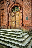 Stairs to the Orthodox Church -. Arched entrance door to the Orthodox brick Church of St. Nicholas in Bialowieza 1895 - Poland Royalty Free Stock Image