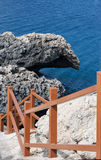 Stairs to the rocky coast. Of mediterranean sea Royalty Free Stock Photography