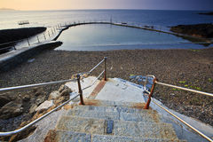 Stairs to the salt water swimming pool Stock Images