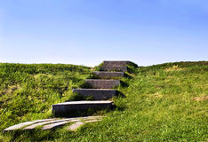 Stairs to the sky. A staircase to the sky with green grass on the sides Royalty Free Stock Image