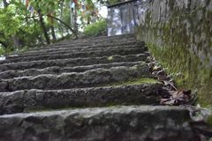 Stairs to the top of the mountain near the temple royalty free stock image