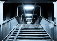 Stairs to the tunnel. Stairs leading to the illuminated tunnel Royalty Free Stock Photos