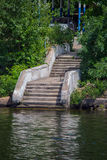 Stairs to the water. Old stone staircase descends to the river Stock Photo