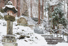 Stairs to yamadera shrine in snowfall Stock Image