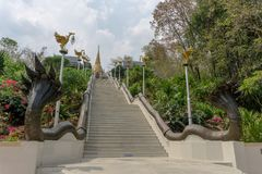 Stairs toward golden Buddhism pagoda with Thai literature animal figures along the way. UDONTHANI, THAILAND -MARCH 17, 2018 : Stairs toward golden Buddhism Stock Photography