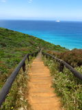 Stairs towards the blue ocean next to Albany Wind Farm. Near Albany, Western Australia Royalty Free Stock Photo