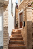 Stairs between traditional greek houses at narrow street of Sitia town on Crete island, Greece Royalty Free Stock Photo