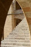 Stairs under arch Stock Images