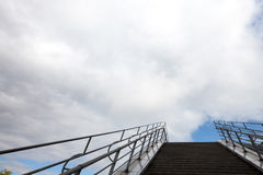 Stairs under cloudy sky Royalty Free Stock Images