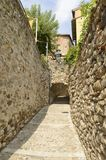 Stairs under stone arch. In alley of  Besalu,  a  medieval town of Girona, Catalonia, Spain Royalty Free Stock Photo