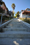 Stairs up an outdoor hill betwween houses Royalty Free Stock Photography
