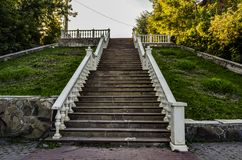 Stairs up in the Park. With stone steps and white railings Stock Photo