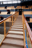 Stairs up to the ship. Stairway leading up to the ship with cannons royalty free stock images
