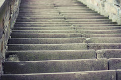 Stairs upstairs. Grey background.Bokeh.Stones Royalty Free Stock Photography