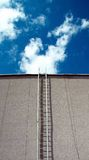 Stairs upwards in the deep blue sky. Stairs upwards in the deep dark blue sky to white clouds Royalty Free Stock Photo