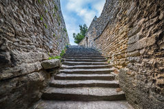 Stairs among the very old walls Stock Images