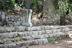 Stairs and walls of ancient city. Stairs and walls and fragment of colonne made of stone in ancient city of Phaselis Stock Photography