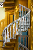 Stairs. White spiral stairs with yellow walls Royalty Free Stock Photography
