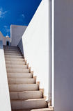 Stairs, white walls and a church. Royalty Free Stock Image