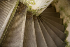 Stairs winding downward in old concrete building Royalty Free Stock Photography